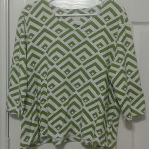 A lady's top from Chico's in good condition